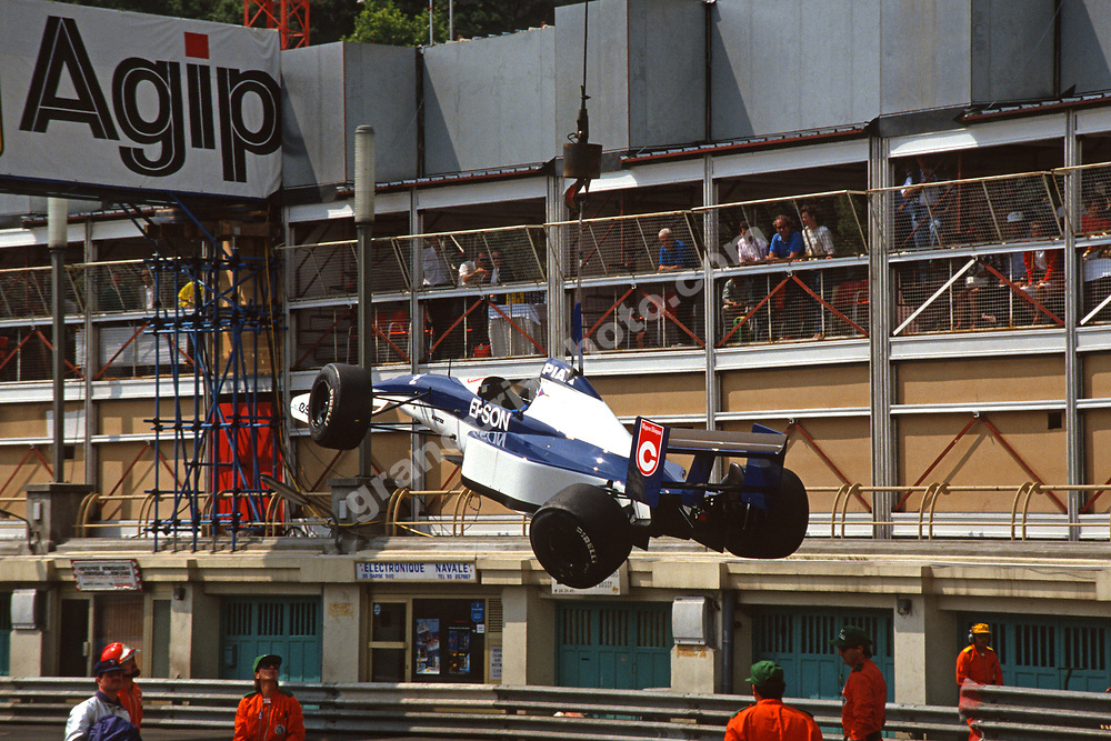 Tyrrell-Ford  of Jean Alesi wreck on a crane after a crash during practice for the 1991 Monaco Grand Prix. Photo: Grand Prix Photo
