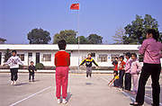 Primary school children skipping during a physical education class, near Huizhou city, China