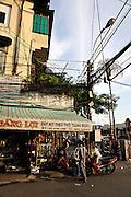 Street corner in late afternoon light. Ho Chi Minh City (Saigon), Vietnam