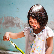 CAPTION: One of Mai Van Cho's grandchildren, Hong, playing at home with her brothers and sisters. When it floods, transport to and from school is a major challenge and Hong and her siblings often have to stay at home. LOCATION: An Binh Ward, Can Tho, Vietnam. INDIVIDUAL(S) PHOTOGRAPHED: Dinh Cam Hong.