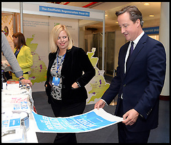 Image ©Licensed to i-Images Picture Agency. 29/09/2014. Birmingham, United Kingdom.  The Prime Minister David Cameron tours the stands in the conference hall on Day 2 of the Conservative Party Conference at the ICC Birmingham. Picture by Andrew Parsons / i-Images