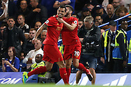 GOAL / CELE - Dejan Lovren of Liverpool (l) celebrates after scoring his teams 1st goal from a corner to make it 0-1 with Adam Lallana of Liverpool. Premier league match, Chelsea v Liverpool at Stamford Bridge in London on Friday 16th September 2016.<br /> pic by John Patrick Fletcher, Andrew Orchard sports photography.