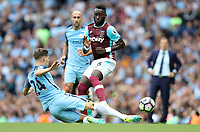Football - Arthur Masuaku of West Ham United and John Stones of Manchester City  during the match at the Etihad Stadium between Manchester City and West Ham United. <br /> <br /> 2016 / 2017 Premier League - Manchester City vs. West Ham United<br /> <br /> -- at The Etihad Stadium.<br /> <br /> COLORSPORT/LYNNE CAMERON