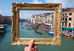 Grand canal in Venice framed by picture frame