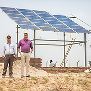 CAPTION: Representatives of AST, an ESCO, at the construction site for the OORJAgram Rural Enterprise Zone. LOCATION: Diara Rasulpur, Saran District, Bihar, India. INDIVIDUAL(S) PHOTOGRAPHED: From left to right: Indradev Rathore and Ravi Shankar.