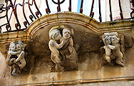 Palazzo La Rocca Baroque sculpted balcony corbels, Ragusa Ibla, Sicily .<br /> <br /> Visit our SICILY HISTORIC PLACES PHOTO COLLECTIONS for more   photos  to download or buy as prints https://funkystock.photoshelter.com/gallery-collection/2b-Pictures-Images-of-Sicily-Photos-of-Sicilian-Historic-Landmark-Sites/C0000qAkj8TXCzro<br /> .<br /> <br /> Visit our EARLY MODERN ERA HISTORICAL PLACES PHOTO COLLECTIONS for more photos to buy as wall art prints https://funkystock.photoshelter.com/gallery-collection/Modern-Era-Historic-Places-Art-Artefact-Antiquities-Picture-Images-of/C00002pOjgcLacqI