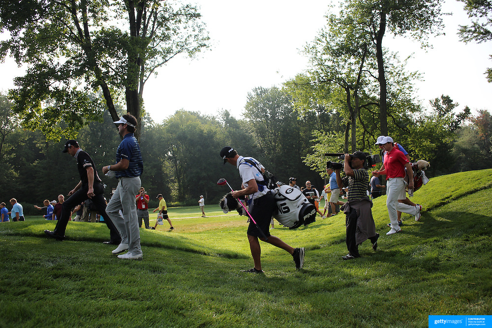 Jimmy Walker, (left), Bubba Watson and Rory McIlroy in the early morning light after an early start during the first round of theThe Barclays Golf Tournament at The Ridgewood Country Club, Paramus, New Jersey, USA. 21st August 2014. Photo Tim Clayton