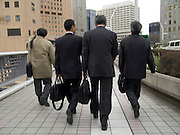 business people rushing to a meeting Shinjuku Tokyo