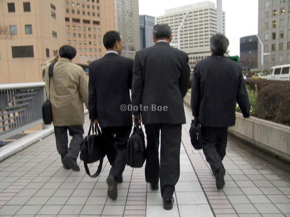 business people rushing to a meeting Shinjuku Tokyo