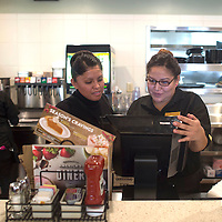 Ursula begay, left, helps Letesheia sage enter a customer's order at the Denny's in Chinle Wednesday. Owner Romero Brown had updated technology put in to track customer orders and improve communication between cooks and waitresses.