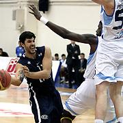 Anadolu Efes's Cenk Akyol (L) during their Turkish Basketball league derby match  Fenerbahce Ulker between Anadolu Efes at Caferaga Sports Hall in Istanbul, Turkey, Saturday 01, 2012. Photo by TURKPIX