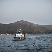 A Greek coast guard boat approaching the port of Lakki. It is a boat like that, that transports the refugees and migrants from Farmakonisi to Leros