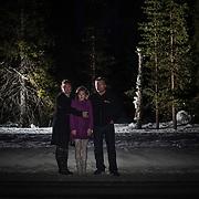 """Kuvattu 12.3.2015 Hannele, Iina ja Jani Palokangas Iinan syntymäpaikalla. <br /> Porttipahta<br /> Matkaa keskussairaalaan: 203 km<br /> 1.3.2004, <br /> kolmen aikaan yöllä. <br /> <br /> Hannele Palokangas: """"Iinan syntymäpaikan muistamme siitä, että Jani kävi ulkona synnytyksen jälkeen ja näki tien vieressä tämän kelon. Jani soittaa torvea aina kun ajamme ohi, vaikka lapset nukkuisivat."""" <br /> <br /> Ivalossa oli oma synnytysosasto vuoteen 1999 asti. Kun se lakkautettiin, pitenivät Inarin ja Utsjoen kuntien äitien synnytysmatkat 200–500 kilometriä. Matka Rovaniemelle on pitkä ja moni synnytys joudutaan tekemään ambulanssissa matkan varrella.<br /> <br /> Hannele, Iina and Jani Palokangas in the place of Iina's birth.<br /> Porttipahta<br /> Distance to hospital: 203 km<br /> 1.3.2004, <br /> 3:00 AM. <br /> <br /> Labour ward in Ivalo was closed in 1999. After that the distance to the nearest labour ward in Rovaniemi is 200 to 500 kilometers. Some of the babies are born on the road."""