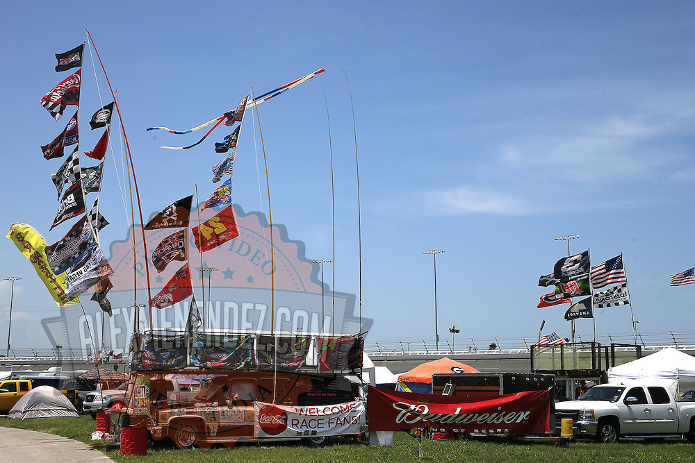 Campers raise driver flags in the infield prior to the 57th Annual NASCAR Coke Zero 400 stock car race at Daytona International Speedway on Sunday, July 5, 2015 in Daytona Beach, Florida.  (AP Photo/Alex Menendez)