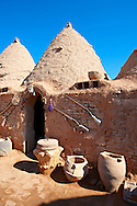 """Pictures of the beehive adobe buildings of Harran, south west Anatolia, Turkey.  Harran was a major ancient city in Upper Mesopotamia whose site is near the modern village of Altınbaşak, Turkey, 24 miles (44 kilometers) southeast of Şanlıurfa. The location is in a district of Şanlıurfa Province that is also named """"Harran"""". Harran is famous for its traditional 'beehive' adobe houses, constructed entirely without wood. The design of these makes them cool inside. 17 .<br /> <br /> If you prefer to buy from our ALAMY PHOTO LIBRARY  Collection visit : https://www.alamy.com/portfolio/paul-williams-funkystock/harran.html<br /> <br /> Visit our TURKEY PHOTO COLLECTIONS for more photos to download or buy as wall art prints https://funkystock.photoshelter.com/gallery-collection/3f-Pictures-of-Turkey-Turkey-Photos-Images-Fotos/C0000U.hJWkZxAbg ."""