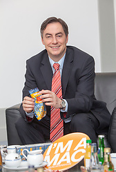 """The half-Scottish Prime Minister David McAllister of Lower Saxony, invited The Scottish Sun's Graeme Donohoe to attend today's cabinet meeting. Pic with some of his election material with the slogan """"I'm a Mac""""..©Michael Schofield."""