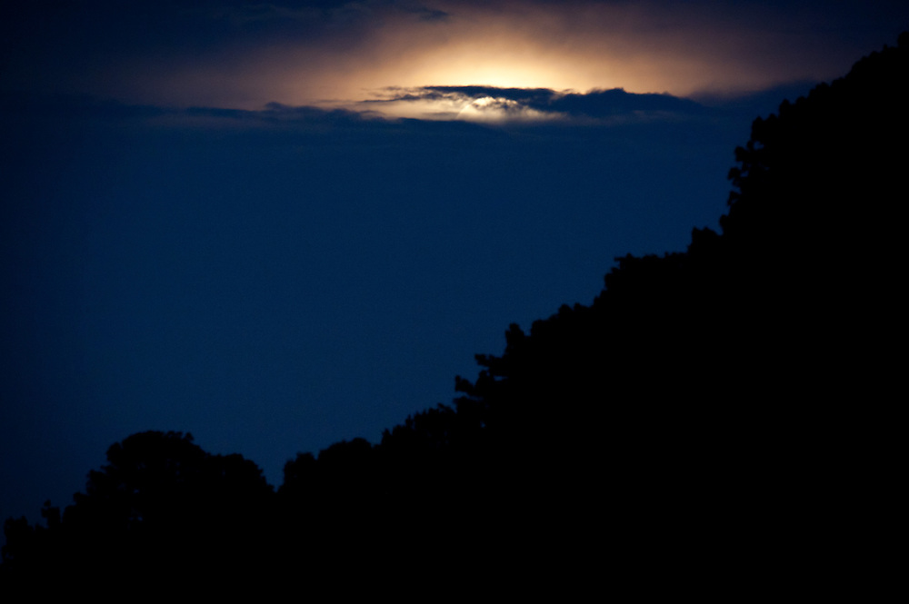 June 23, 2013; Griffin, GA, USA; Photos of moon over Cheatham Road Reservoir in Spalding County. Photo by Kevin Liles/kevindliles.com