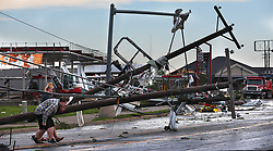 May 23, 2019, Jefferson City, Missouri, U.S: Residents dodge utility poles along the commercial district on Ellis Boulevard after a tornado ripped through their community on Thursday. At least three people are dead and dozens injured. (Credit Image: © Robert Cohen/TNS via ZUMA Wire)