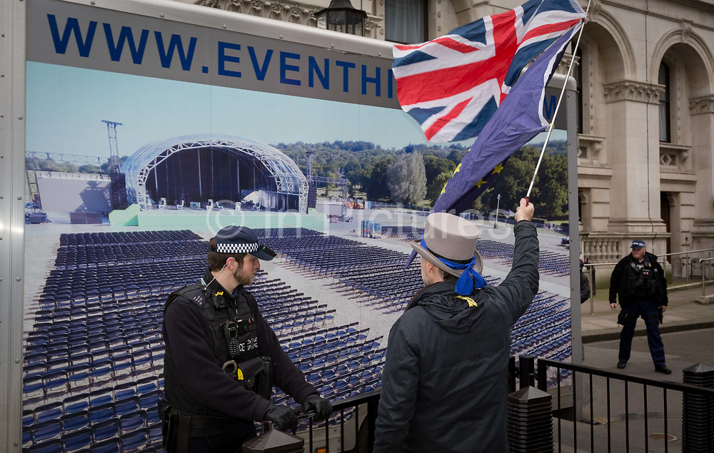 An events van leaves the Prime Ministers official residence in Downing Street while the EUs Chief negotiator Michel Barnier met Theresa May in London, discussing the next stage of Brexit. An anti-Brexit protester holds the Union Jack and EU flags in Whitehall, on 5th February 2018, in London England.