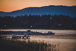 THEMENBILD - Boote am Ufer am Faakersee bei Sonnenuntergang, aufgenommen am 20. Juni 2018 in Faak am See, Österreich // Boats on the shore at Faakersee at sunset, Faak am See, Austria on 2018/06/20. EXPA Pictures © 2018, PhotoCredit: EXPA/ JFK
