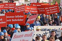 07 NOV 2002, BERLIN/GERMANY:<br /> Demonstraten mit Schildern, Demonstration gegen die Kuerzung der Eigenheimzulage, am Startpunkt Alexanderplatz<br /> IMAGE: 20021107-01-036<br /> KEYWORDS: Demo, Bau, Baugewerbe, Kürzung, Demostrant, demonstrator, Subventionen