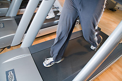 Woman working out on a treadmill at the gym,