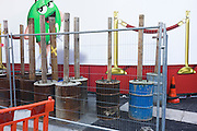 Construction site bollards and fence at a new M&Ms theme shop near Liecester Square in central London.