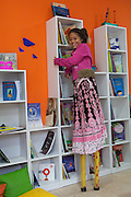 Ketlin trys out her stilts in the community library, Biblioteca Comunitaria do Arquipelago, Porte Alegre, Brazil. <br /> <br /> Once a week the children have a music and poetry session where they go out in to the community on stilts singing, playing music and reciting poetry.<br /> <br /> Cirandar is working in partnership with  C&A and C&A Instituto to implement a network of Community Libraries in eight communities of Porto Alegre.