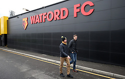 Fans arrive for the FA Cup quarter final match at Vicarage Road, Watford.