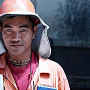 Portrait of asian male workman 30s