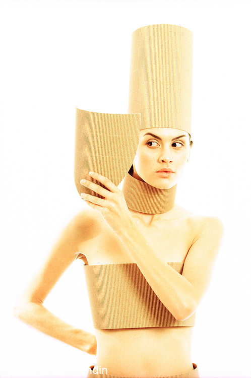 Portrait of woman covered corrugated cardboard glancing away