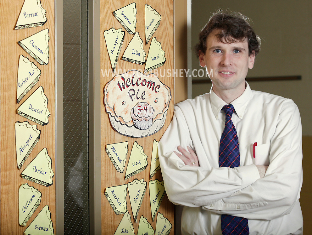 Sanfordville Elementary School teacher Colin McLaughlin poses for the portrait by the door to his classroom in Warwick on Thursday, Feb. 3, 2011.