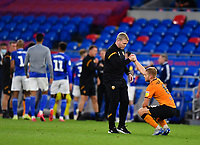 Football - 2019 / 2020 Sky Bet (EFL) Championship - Cardiff City vs. Hull City<br /> <br /> Hull City head coach Grant McCann with Daniel Batty at the final whistle after their 3-0 defeat and relegation from the Championship, at the Cardiff City Stadium.<br /> <br /> COLORSPORT/ASHLEY WESTERN