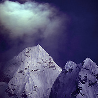 The moon rises over 6828-meter (mount) Ama Dablam, in the Khumbu Region of Nepal, considered by many to be one of the most beautiful mountains in the world.