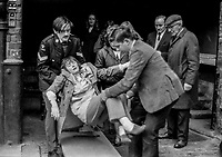 A women is carried from GNR railway station, Great Victoria Street, Belfast, N Ireland, UK, following a Provisional IRA explosion, 22nd March 1972.G.N.R. Whilst there was extensive damage there was no serious injuries. 197203220068f<br />