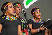 Pilton, Somerset, UK. The Langa methodist Church Choir from South Africa play the Pyramid Stage to a small, reflective but generally appreciative crowd - The 2019 Glastonbury Festival, Worthy Farm, Glastonbury.