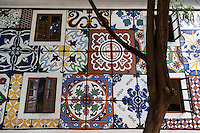 Modern Azulejos  in Fontainhas -  the old quarter of Panaji Goa.  The area is known for its colorful buildings, architecture and relaxed lifestyle which is the envy of the rest of the state.  Azuelos are normally blue, an artifact left over from the Portuguese colonial period, though they have taken on a more colorful, Indian flavor in Goa from time to time.