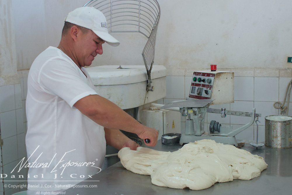 Bakers making bread at a bakery that's part of one of the Rations Stores in Trinidad, Cuba.