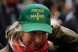 """© Licensed to London News Pictures. 07/02/2017. London, UK. A supporters of Sergeant Alexander Blackman wears a """"JUSTICE FOR MARINE A"""" cap, outside the Royal Courts of Justice in London where Sgt Blackman is due to start an appeal against his life sentence for the murder of a wounded Taliban fighter in Afghanistan in 2011.  Photo credit: Ben Cawthra/LNP"""