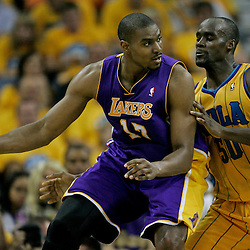 April 22, 2011; New Orleans, LA, USA; Los Angeles Lakers center Andrew Bynum (17) is guarded by New Orleans Hornets center Emeka Okafor (50) during the second quarter in game three of the first round of the 2011 NBA playoffs at the New Orleans Arena.    Mandatory Credit: Derick E. Hingle