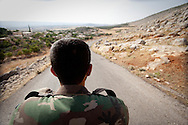 A Free Syrian Army (FSA) soldier drives his motorbike through Idlib province, in an area which is currently under opposition control, and a stronghold of the FSA. Kastan, Idlib, Syria. 15/06/2012
