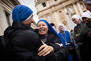 Nuns hug after the pre-conclave mass in St. Peter's Square during the first day of conclave and the selection of the new Pope in Vatican City, March 12, 2013. Photograph by Todd Korol