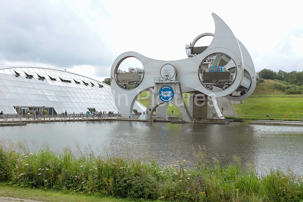 The Falkirk Wheel in Scotland is the world's first and only rotating boat lift and connects the Forth and Clyde Canal with the Union Canal. The lift opened in 2002, reconnecting the two canals for the first time since the 1930s as part of the Millennium Link project.