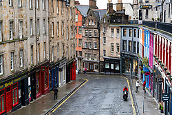 Edinburgh, Scotland, UK. 6 February 2021. The Old town of Edinburgh is almost deserted on a Saturday afternoon during national Covid-19 lockdown. All non essential shops including all tourist souvenir shops are closed as are restaurants and cafes. Pic; Historic Victoria Street is almost deserted.  Iain Masterton/Alamy Live News