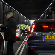 Three Rising Up! activists have blockaded the main access road into Heathrow Terminals 1, 2 and 3, by chaining themselves to a vehicle in protest against the proposed 3rd runway, Februrary 20th, 2017. The activists are protesting against the proposed third runway by the Government, which goes against the needed cuts to CO2 emmissions.