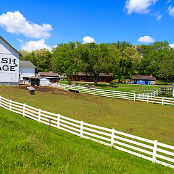 Strasburg, PA, USA - May 23, 2018: A white barn at the Amish Village in Lancaster County, a popular tourist attraction.