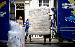 © Licensed to London News Pictures. 16/07/2016. London, UK. A mattress being placed in a van for David Cameron. Removal men begin to take items from numbers 10 and 11 at Downing Street at the end of the week that saw Prime Minister David Cameron leave and Theresa May arrive. Photo credit: Ben Cawthra/LNP