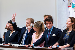 © Licensed to London News Pictures. 07/10/2016. London, UK.   Sotheby's staff make bids on behalf of telephone clients at Sotheby's Italian and Contemporary Art evening sale in New Bond Street. Photo credit : Stephen Chung/LNP