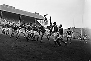 After gaining possession in a line out, Culliton, Irish forward, is tossed head over heels in a collission with Mommejat, French forward,..Irish Rugby Football Union, Ireland v France, Five Nations, Landsdowne Road, Dublin, Ireland, Saturday 18th April, 1959,.18.4.1959, 4.18.1959,..Referee- D G Walters, Welsh Rugby Union, ..Score- Ireland 9 - 5 France, ..Irish Team, ..N J Henderson, Wearing number 15 Irish jersey, Full Back, N.I.F.C, Rugby Football Club, Belfast, Northern Ireland, ..A J O'Reilly, Wearing number 14 Irish jersey, Right Wing, Old Belvedere Rugby Football Club, Dublin, Ireland, and, Leicester Rugby Football Club, Leicester, England, ..M K Flynn, Wearing number 13 Irish jersey, Right Centre, Wanderers Rugby Football Club, Dublin, Ireland, ..D Hewitt, Wearing number 12 Irish jersey, Left centre, Queens University Rugby Football Club, Belfast, Northern Ireland,..N H Brophy, Wearing number 11 Irish jersey, Left wing, University College Dublin Rugby Football Club, Dublin, Ireland, ..M A F English, Wearing number 10 Irish jersey, Outside Half, Bohemians Rugby Football Club, Limerick, Ireland,..A A Mulligan, Wearing number 9 Irish jersey, Scrum Half, London Irish Rugby Football Club, Surrey, England, ..B G Wood, Wearing number 1 Irish jersey, Forward, Garryowen Rugby Football Club, Limerick, Ireland, ..A R Dawson, Wearing number 2 Irish jersey, Captain of the Irish team, Forward, Wanderers Rugby Football Club, Dublin, Ireland, ..S Millar, Wearing number 3 Irish jersey, Forward, Ballymena Rugby Football Club, Antrim, Northern Ireland,..W A Mulcahy, Wearing number 4 Irish jersey, Forward, University College Dublin Rugby Football Club, Dublin, Ireland, ..M G Culliton, Wearing number 5 Irish jersey, Forward, Wanderers Rugby Football Club, Dublin, Ireland, ..N Murphy, Wearing number 6 Irish jersey, Forward, Cork Constitution Rugby Football Club, Cork, Ireland,..P J A O' Sullivan, Wearing  Number 7 Irish jersey, Forward, Galwegians Rugby Football Club, Galway, Irela