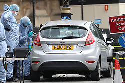 August 14, 2018 - London, United Kingdom - Scenes of crime officers examine the car after the suspected terror crash in Westminster. (Credit Image: © Stephen Lock/i-Images via ZUMA Press)